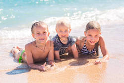 48650281-happy-kids-on-the-beach-having-fun.jpg